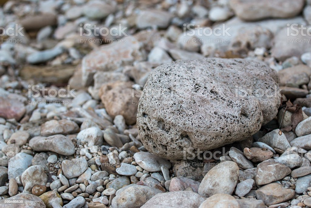 Various size rocks by the river stock photo