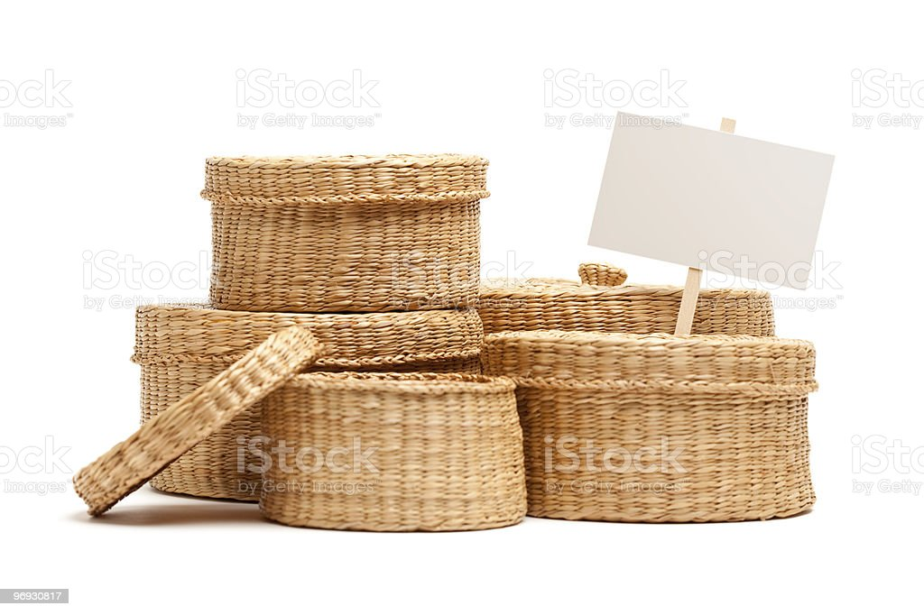 Various Sized Wicker Baskets with Blank Sign on White royalty-free stock photo