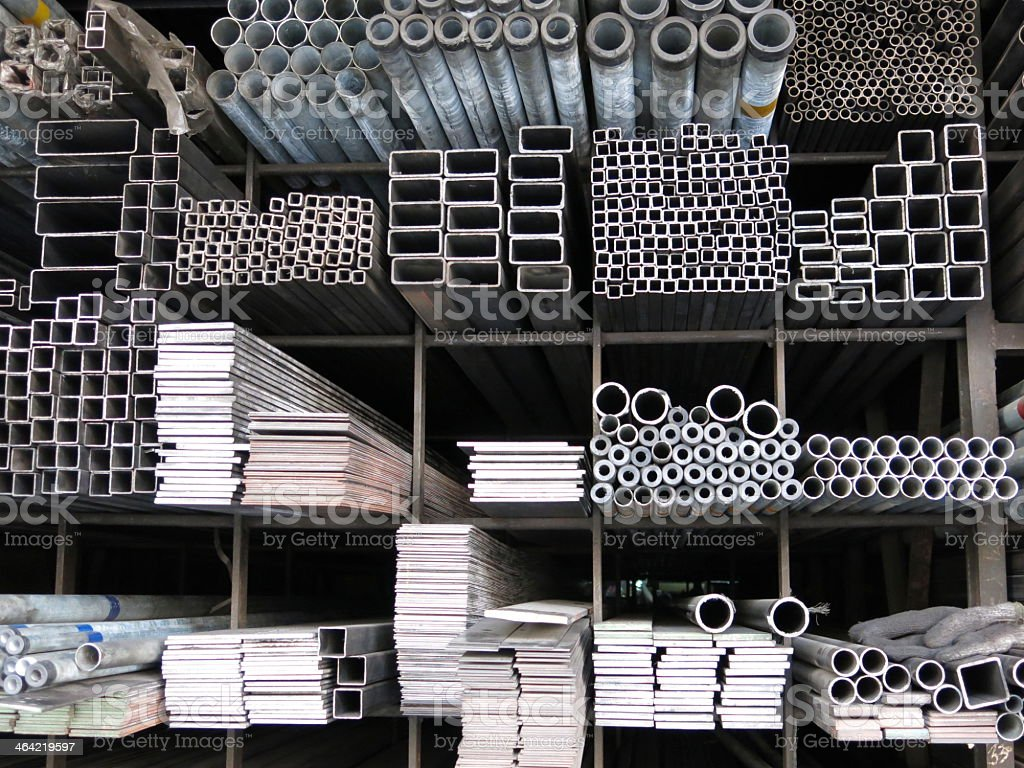 Various sizes steel rods and iron profiles stacked up stock photo