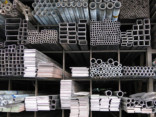 various sizes steel rods and iron profiles stacked up - steel stock photos and pictures