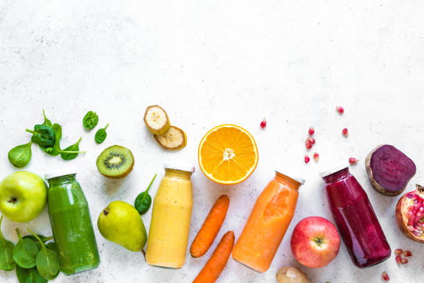 Various smoothies bottles and ingredients Various smoothies or juices in bottles and ingredients on white, healthy diet detox vegan clean food concept, top view, copy space. detox stock pictures, royalty-free photos & images