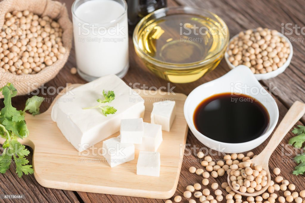 Various soy products with soy sauce, tofu, oil, soy bean and soy milk. stock photo