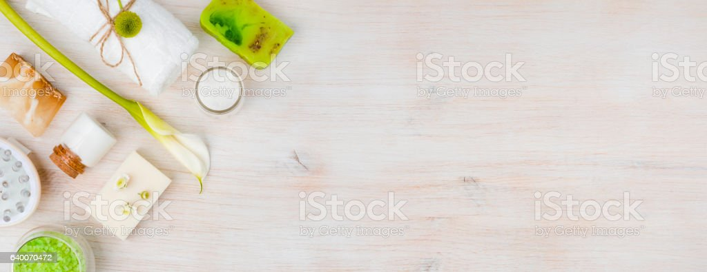 Various spa products on wood with copy space at right stock photo