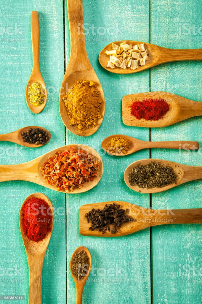 Various spice on wooden spoons with herbs zbiór zdjęć royalty-free
