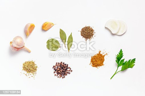 Various spices and herbs on white background. Set of spice, top view.