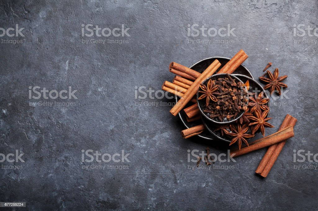 Various spices bowls over stone stock photo
