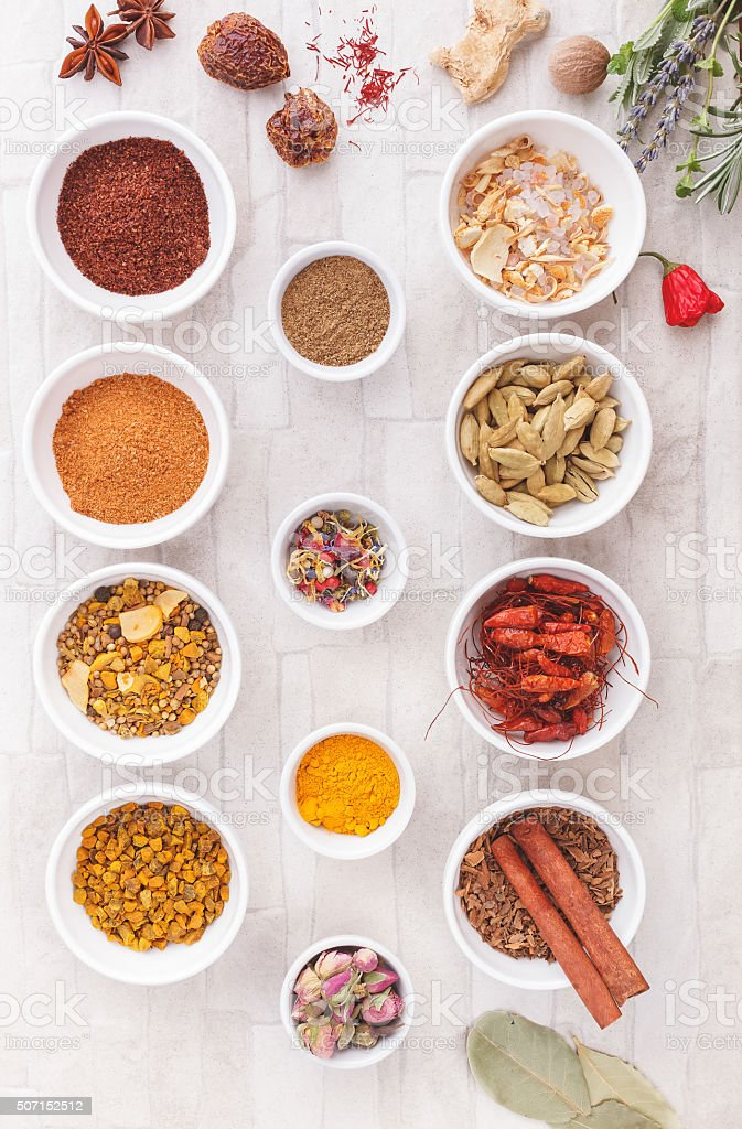 Various spices, dried and fresh herbs on table stock photo