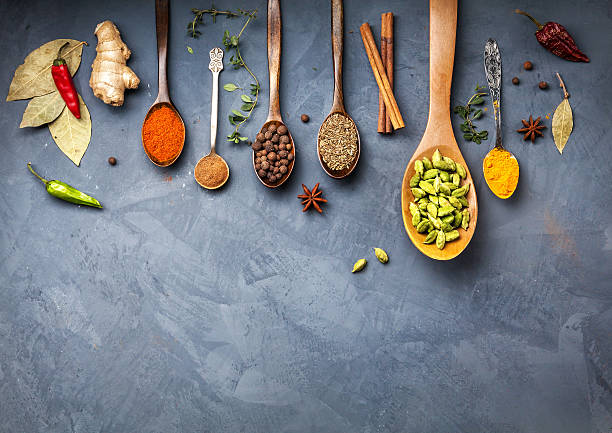 Various Spices near blackboard at blue stone background​​​ foto