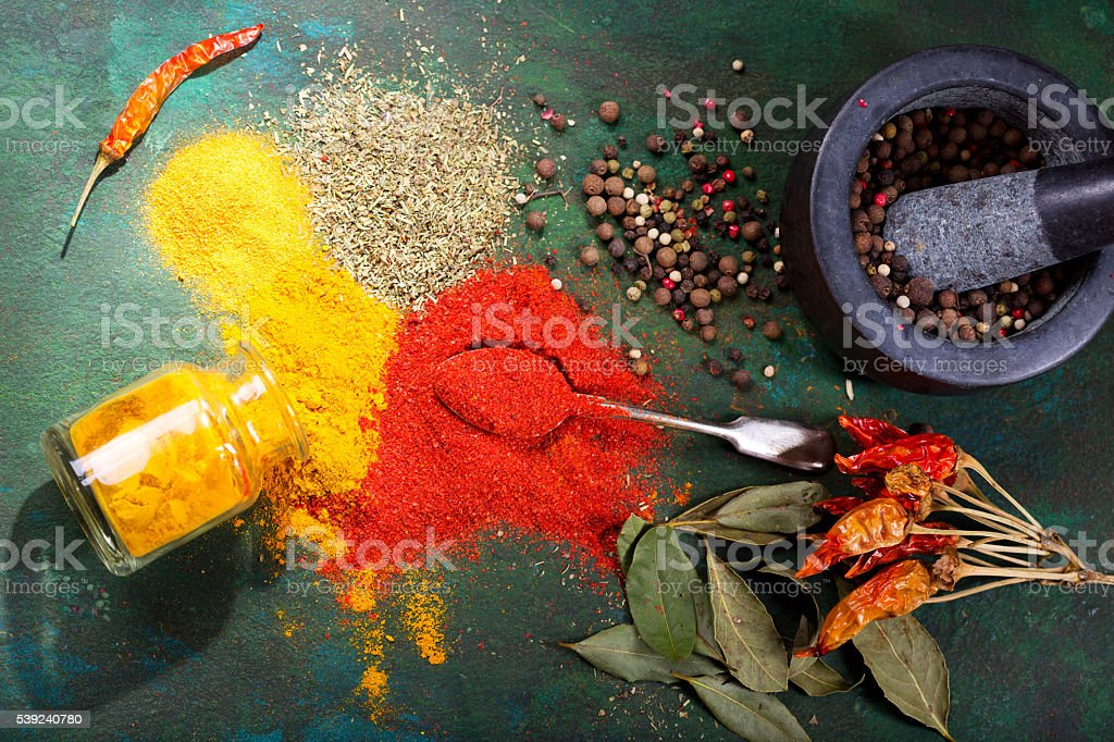 various spices on green background royalty-free stock photo