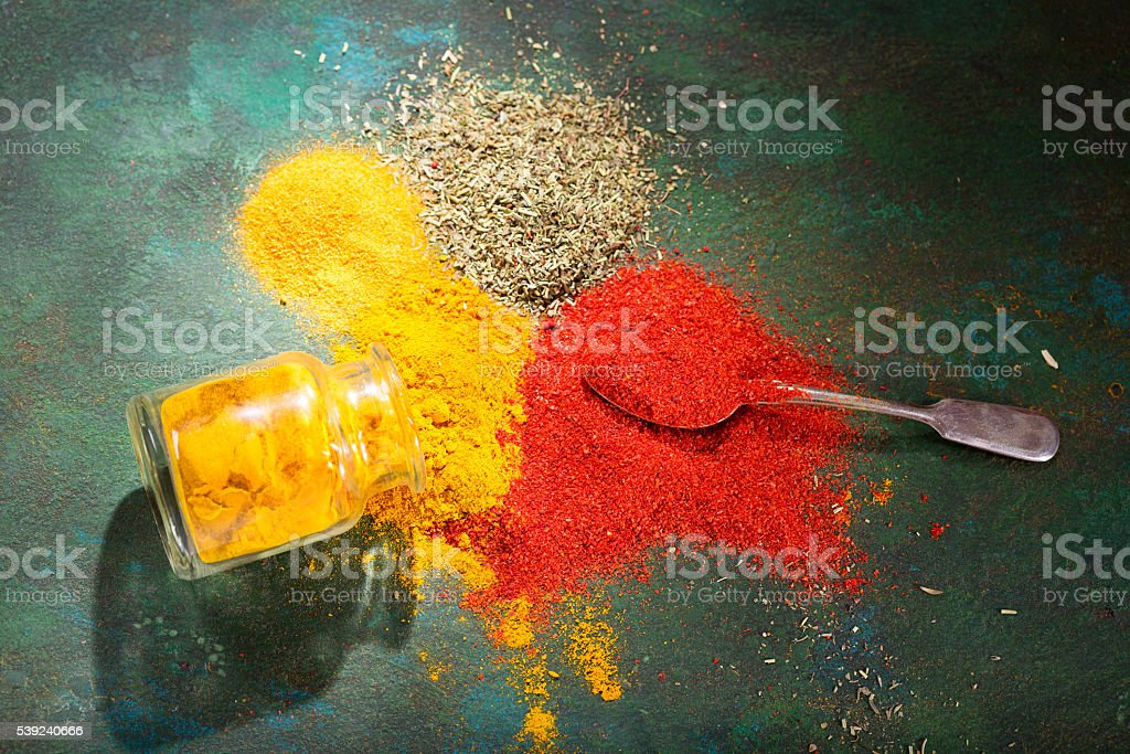 various spices on old green background royalty-free stock photo