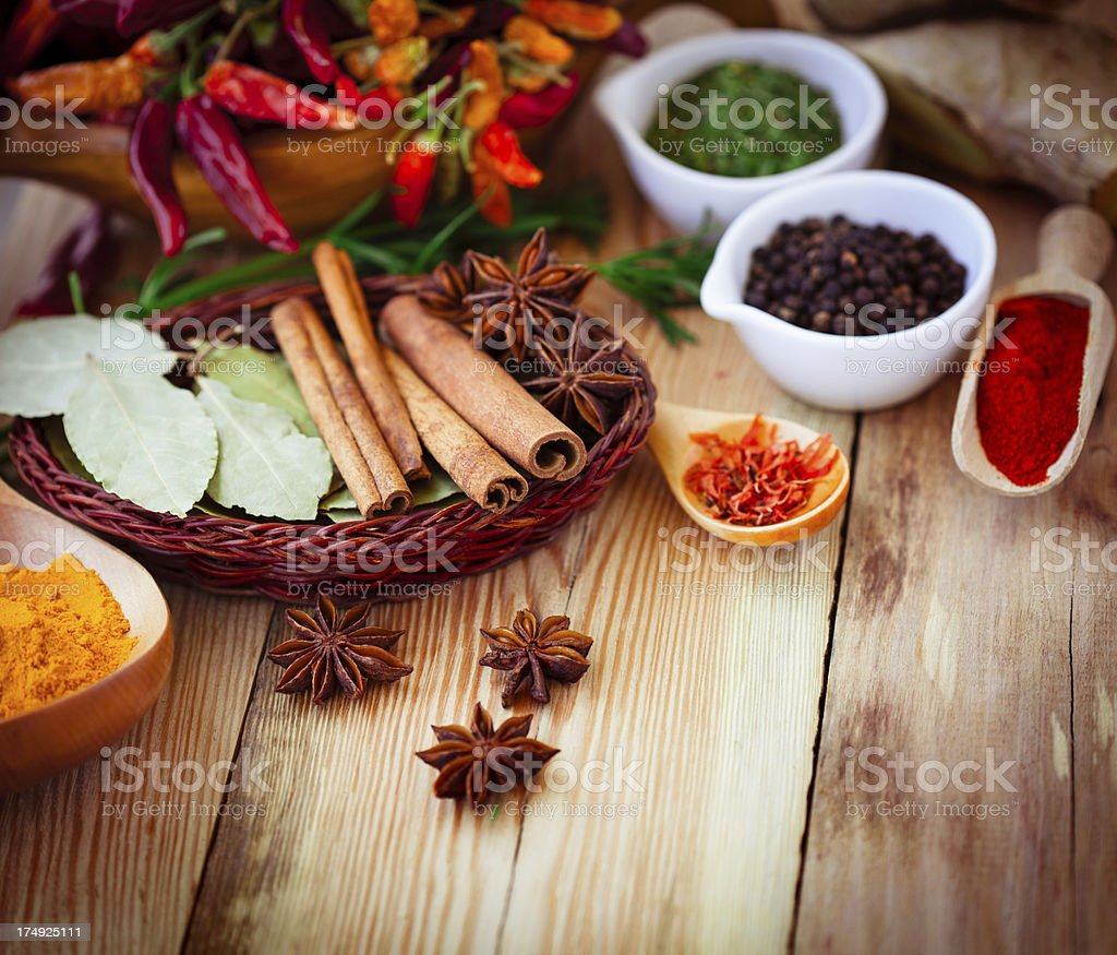 Various spices on old wooden table royalty-free stock photo