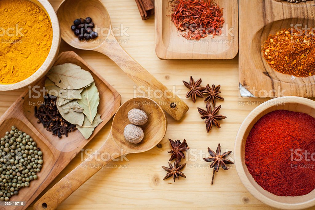 Various spices on old wooden table stock photo