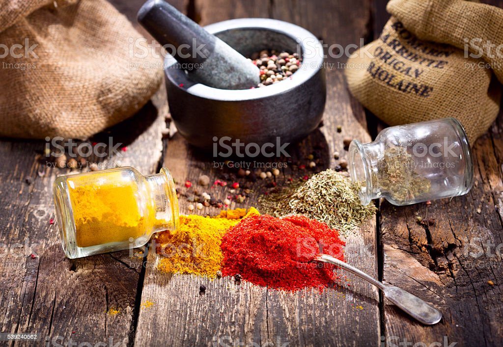 various spices on wooden table royalty-free stock photo