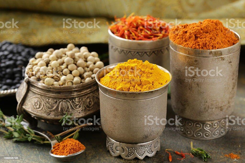 various spices (turmeric, paprika, saffron, coriander) royalty-free stock photo