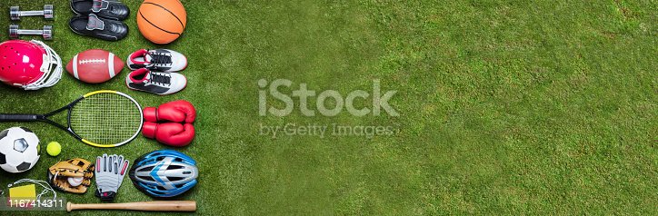 istock Various Sport Equipments On Grass 1167414311