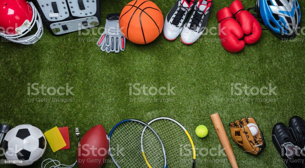 Various Sport Equipments On Grass High Angle View Of Various Sport Equipments On Green Grass Above Stock Photo