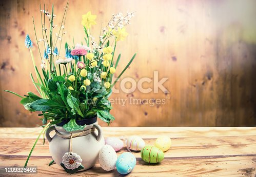 921112244 istock photo Various Spring Flowers and Easter Eggs on Wooden Background 1209326492