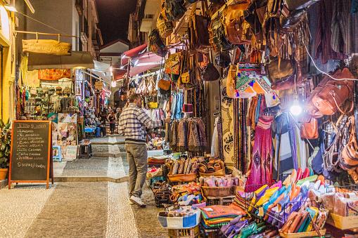 Granada, Spain - November 1, 2017: Various stalls in Calle Caldereria Nueva street in Granada.