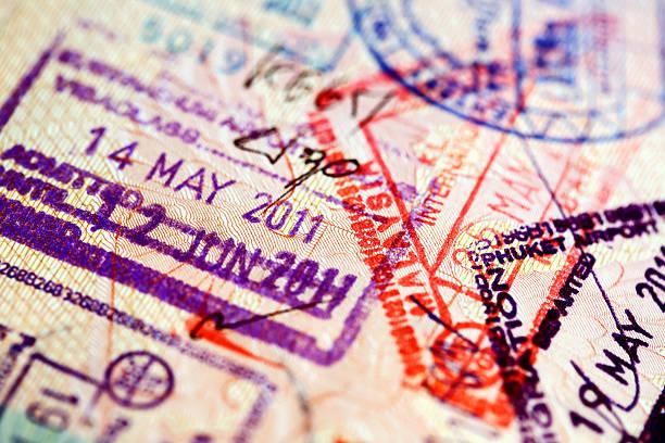 Various stamps inside passport stock photo