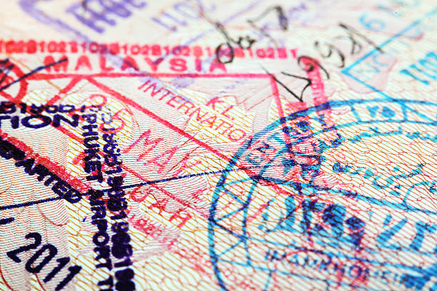 Various stamps inside passport Close-up of passport with various stamps (Thailand, Malaysia, S.Korea, Iran) pasport malaysia stock pictures, royalty-free photos & images