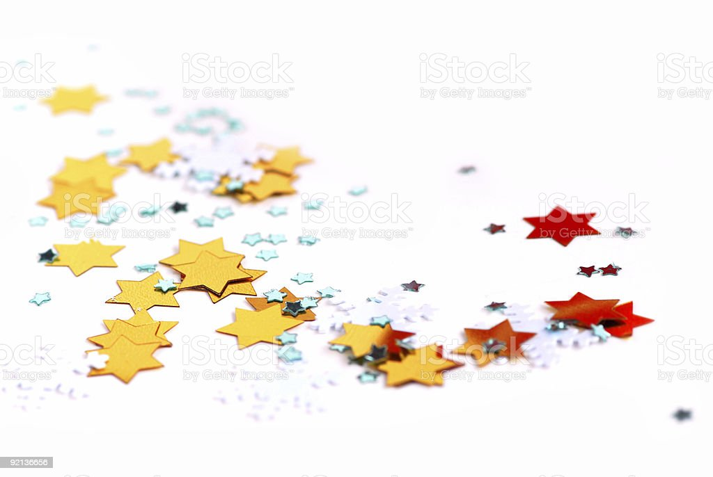 Various star shaped confetti set on a white background  royalty-free stock photo