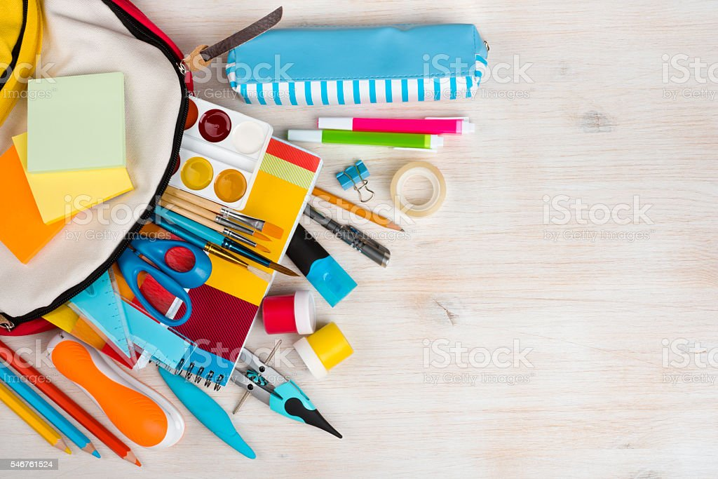 Various stationery school and office supplies over wooden texture background ストックフォト