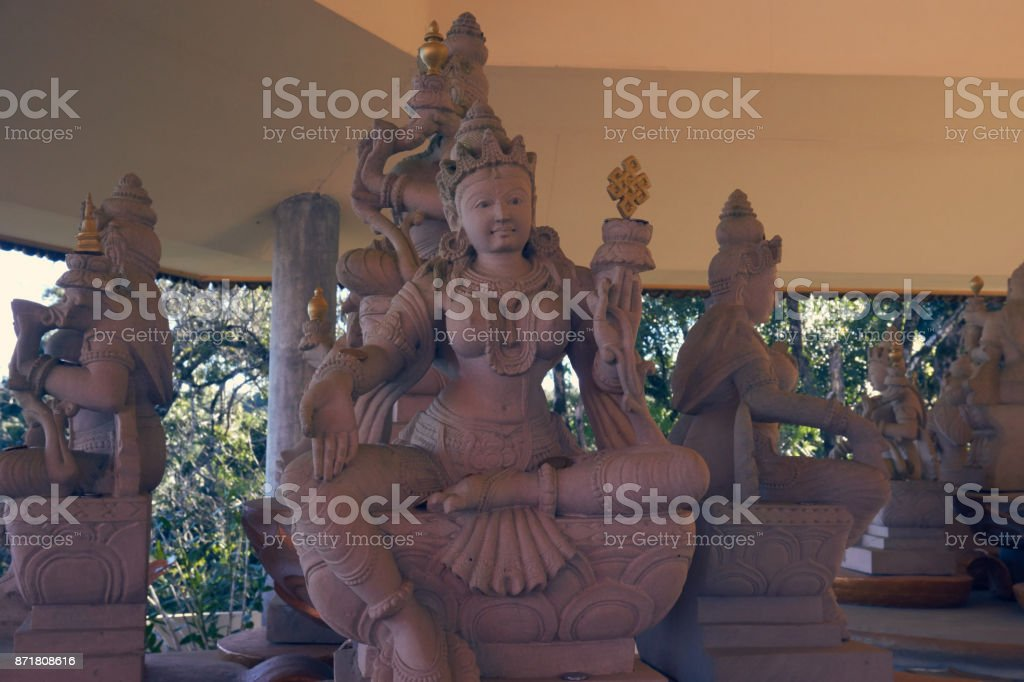 Various statues of Buddha in Buddhist temple. stock photo