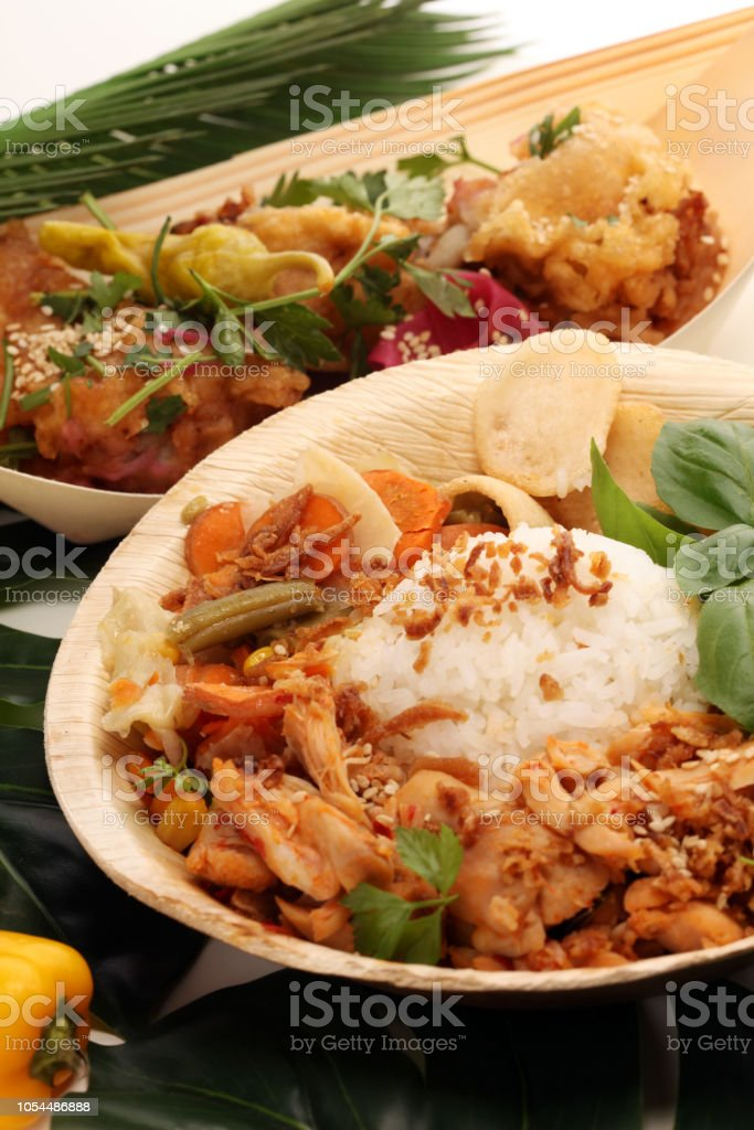Various Street Food With Chicken Wings On Rustic Background
