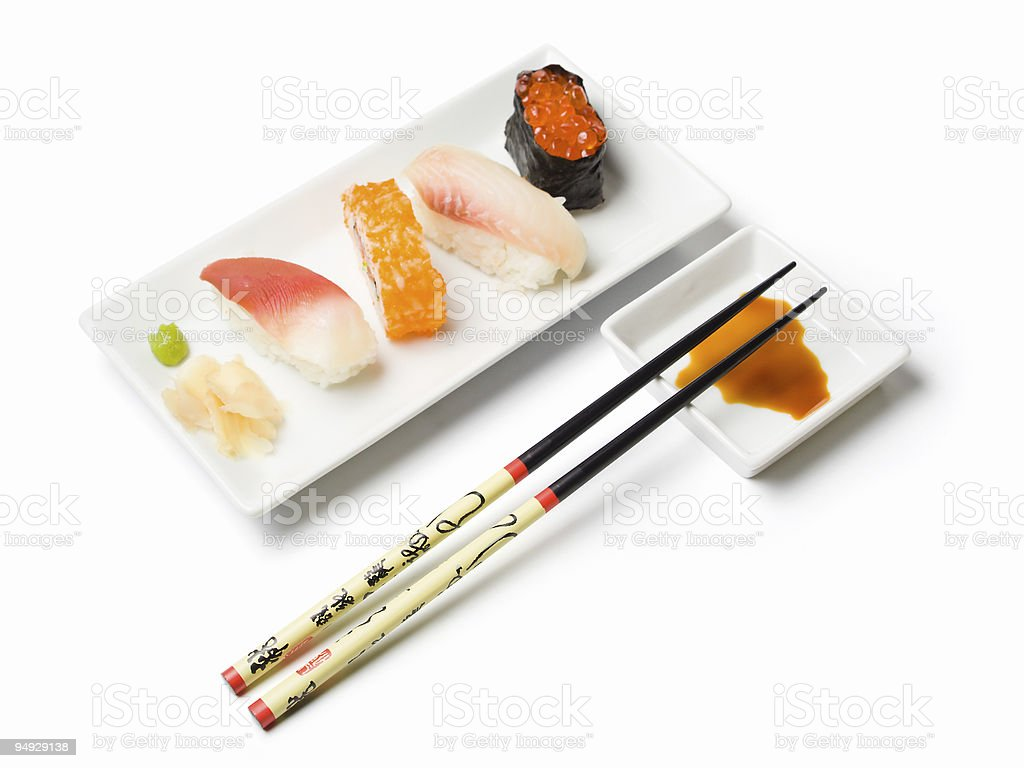 various sushi and chopsticks arranged on plates royalty-free stock photo