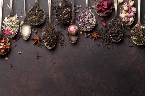 Various tea in spoons. Black, green and red tea Various tea in spoons. Black, green and red tea. Top view with space for your text tea crop stock pictures, royalty-free photos & images