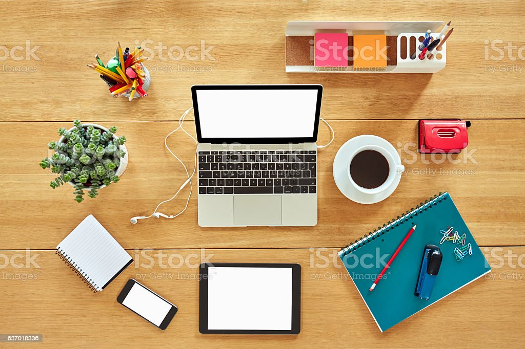 Various technologies with office supplies, coffee cup and plant stock photo