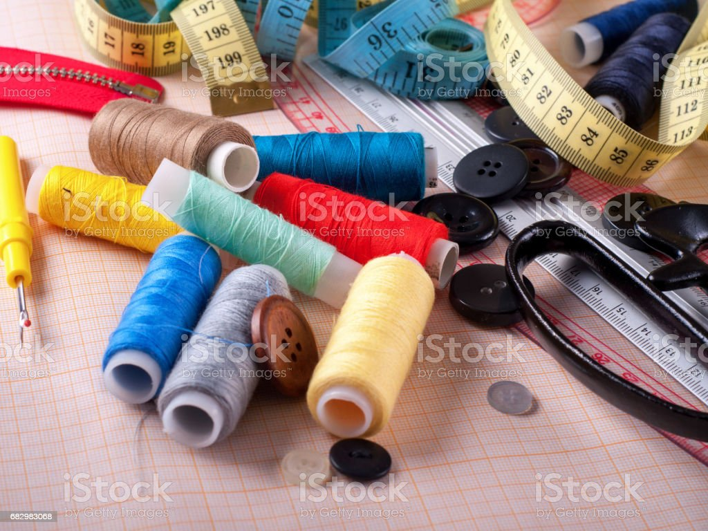 Various threads on tracing paper closeup stock photo