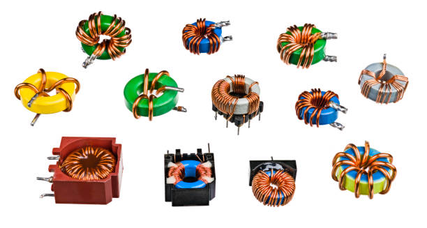Various toroidal inductors and transformers isolated on a white background. Induction coils stock photo