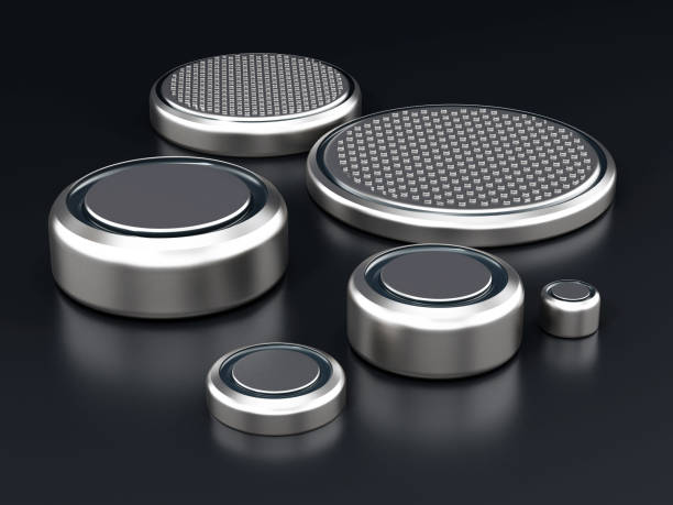 Various type of button cells standing on black surface Various type of button cells standing on black surface. anode stock pictures, royalty-free photos & images