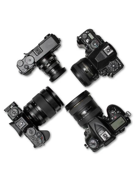 Various types and sizes of digital camera views from above. stock photo