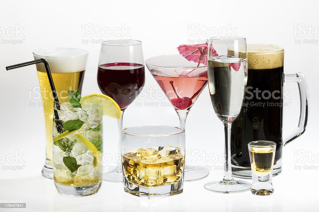 Various types of alcohol on a white background stock photo