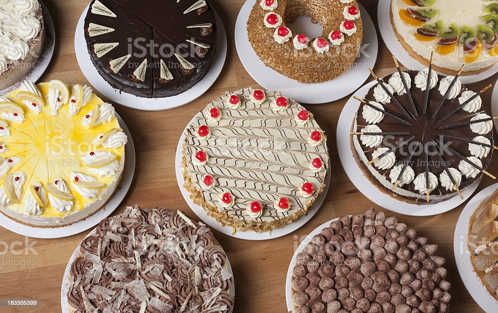 Various types of cake on a table stock photo