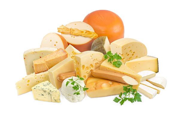 various types of cheese on a light background - beemster stockfoto's en -beelden