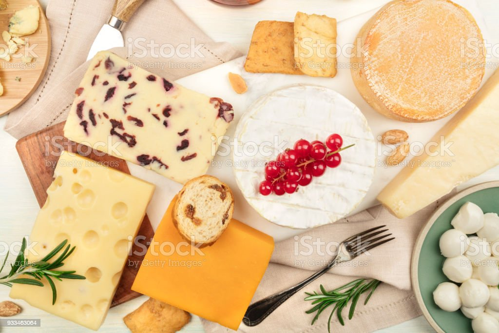 Various types of cheese on a light background stock photo
