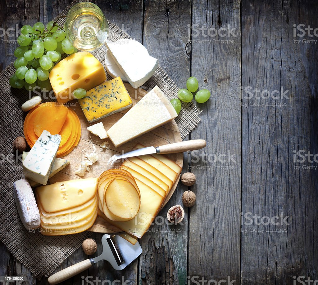 Various types of cheese on vintage boards stock photo