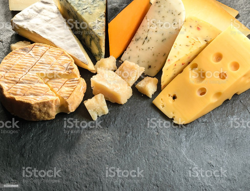 Various types of cheese with empty space background stock photo