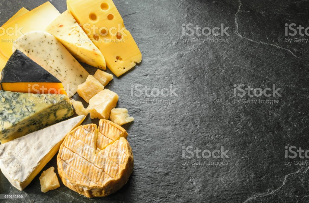 Various types of cheese with empty space background royalty-free stock photo