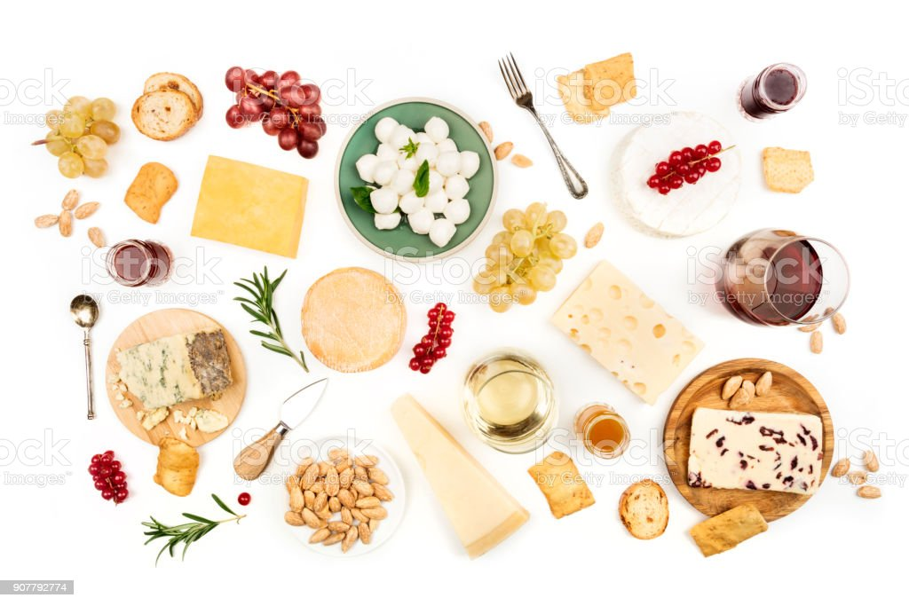 Various types of cheese with wine on a white background stock photo