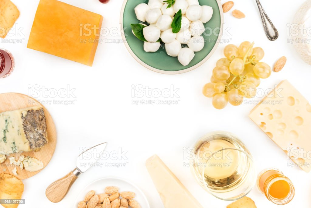 Various types of cheese with wine on a white background with place for text stock photo