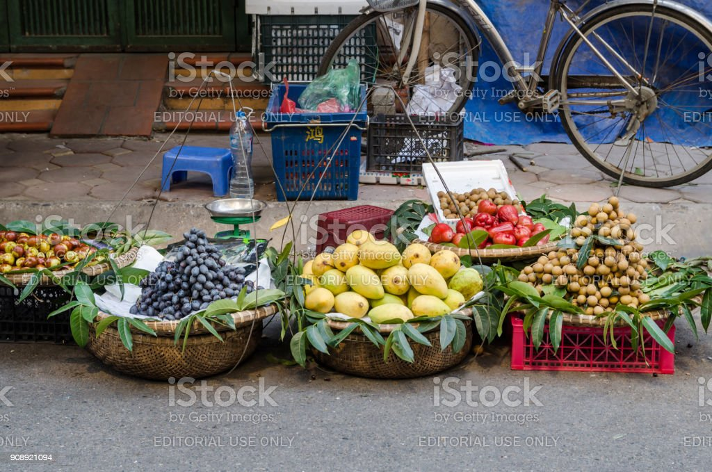 Various types of fruits selling from the traditional hanging baskets...