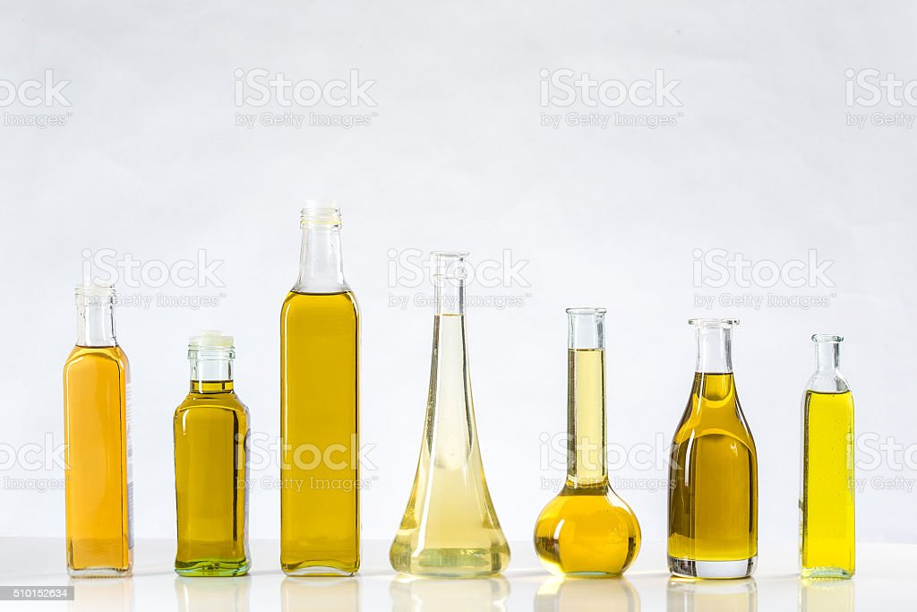 Various types of oil in bottles stock photo