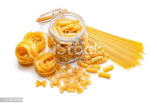 Various types of raw pasta shot from above on white background. Types of pasta included in the composition are spaghetti, rigatoni, bow tie pasta and fettuccine. Predominant colors are yellow and white. High key DSRL studio photo taken with Canon EOS 5D Mk II and Canon EF 100mm f/2.8L Macro IS USM.