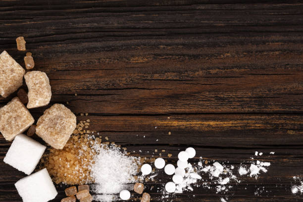 Various types of sugar from above on wooden table stock photo