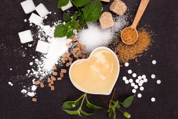 various types of sugar from above - sweeteners stock photos and pictures