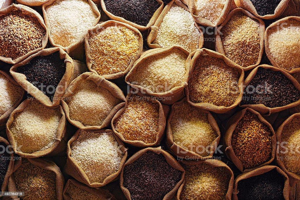 Various types of Thai rice in burlap sacks. stock photo
